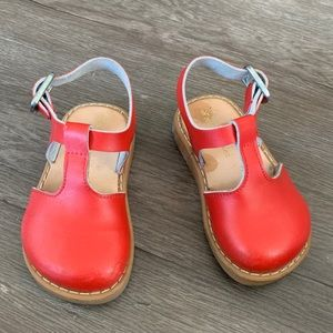 Freshly picked red baby girl shoes
